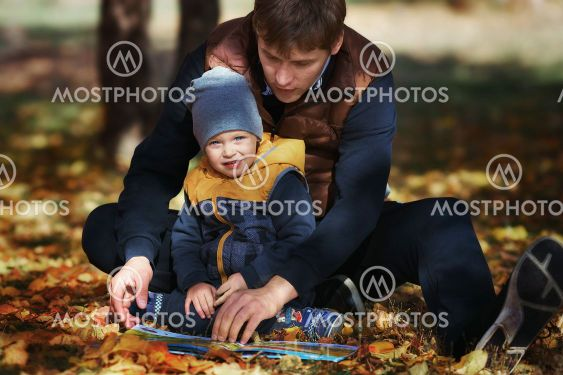 Father's Day. A young father and son in the park on the...