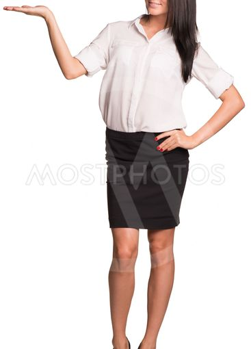 Beautiful businesswomen standing and showing empty palm