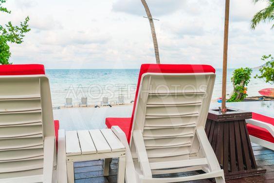Beautiful beach chairs with umbrella around outdoor...