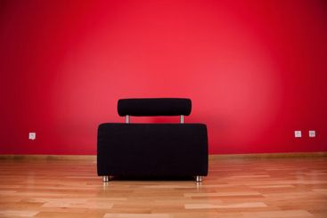 couch next a red wall