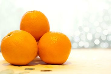 Close up of fresh, ripe and juicy orange fruits