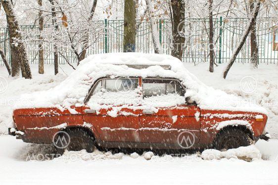 Red car in snowfall
