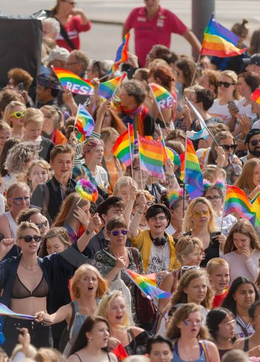 Young participants at the pride parade in Stockholm with...