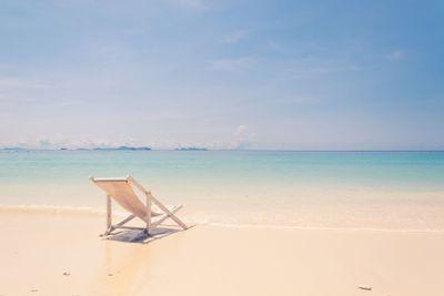 beach chair on beach with blue sky - soft focus with film...