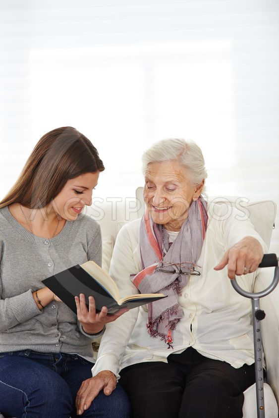 Woman in community service reading to seniors