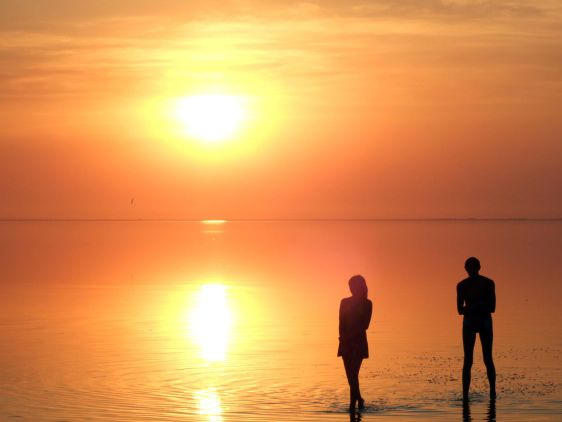 A black silhouette of a children on a sunset 2
