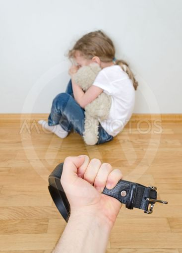 Little girl crying in the corner. Domestic violence...