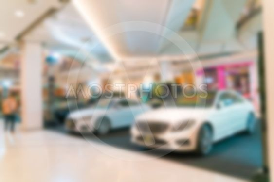 Abstract blurred photo of motor show