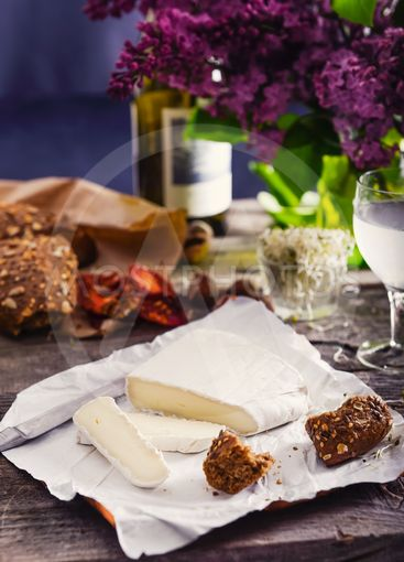 Brie type of cheese. Camembert cheese. Fresh Brie cheese...