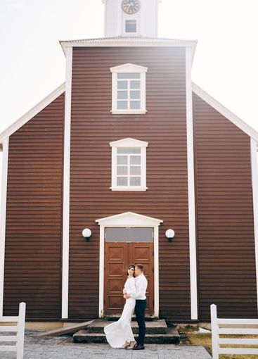 Destination Iceland wedding. Wedding couple in front of...