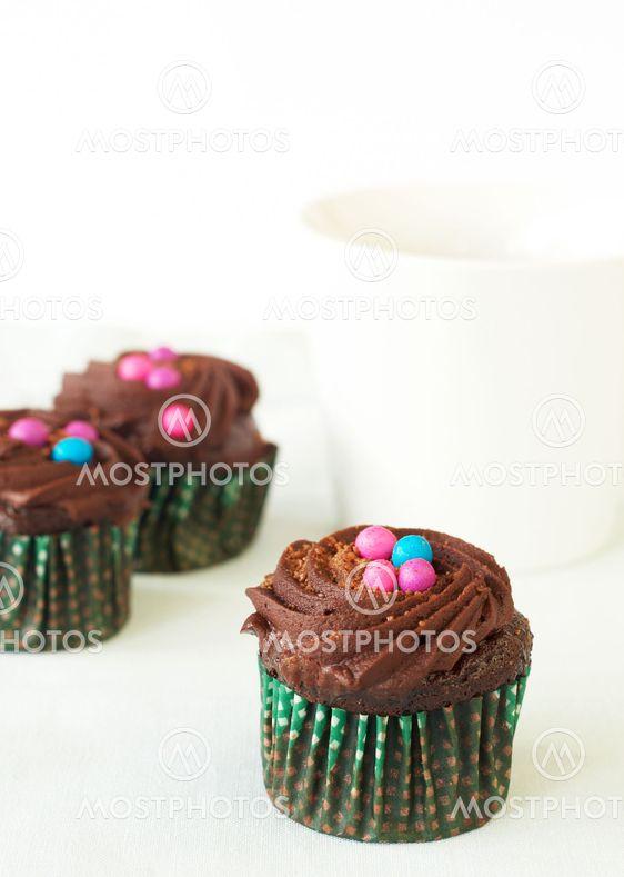 Miniature chocolate cupcakes and coffee