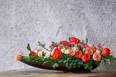 Flower arrangement in wooden tray