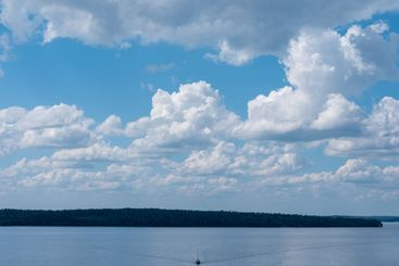 White cloud formation over water