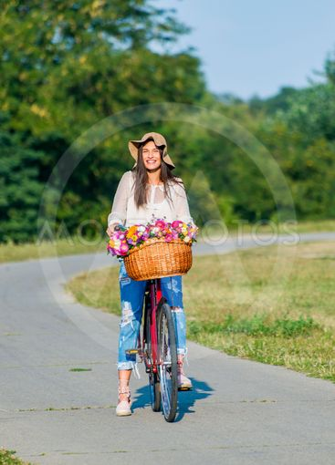 Young girl rides a bicycle