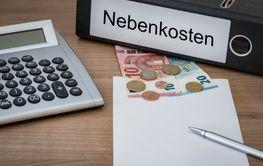 Nebenkosten written on a binder