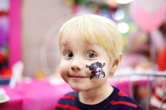 Face painting for cute little boy during kids birthday...