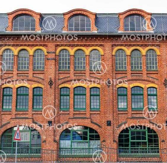 red brick facade of old industrial building