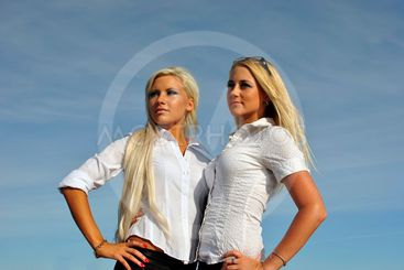 Two blonde girls on sky background