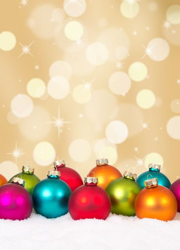 Christmas balls golden background with snow and copyspace