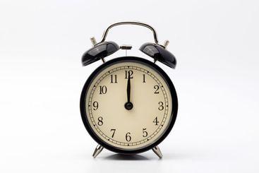 alarm clock shows twelve o'clock