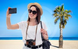 portrait of young beautiful woman tourist taking selfie...