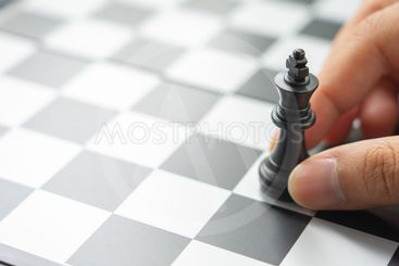Businessman holding a King Chess is placed on a...