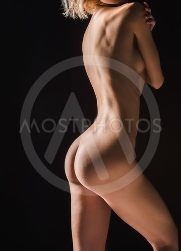 partial view of nude sexy young woman isolated on black
