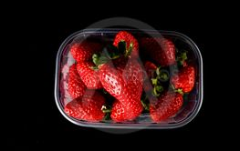 fresh strawberries in box isolated