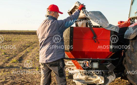 farmer preparing artificial fertilizers for work