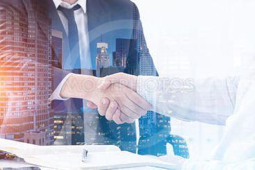 Handshake in morning city