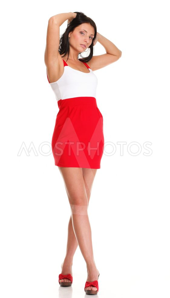 Portrait of sexy brunette in red white dress isolated