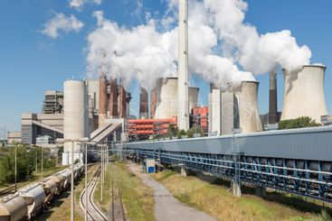 Cooling towers and smokestacks coal fired power plant in...