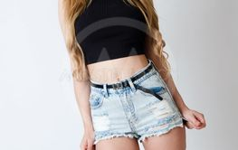 Girl with black top and jeans shorts