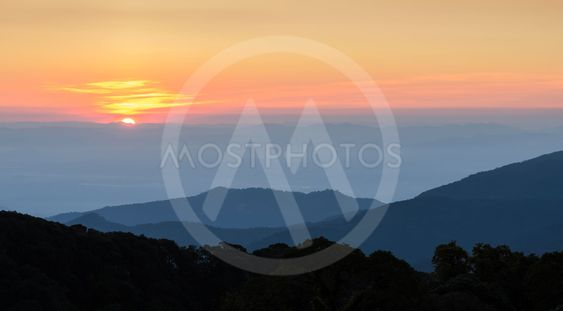 Stunning view of sunrise with mountain ranges
