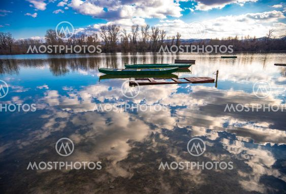 Small boats on the calm lake