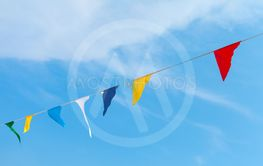 Colorful triangle flags hanging on rope