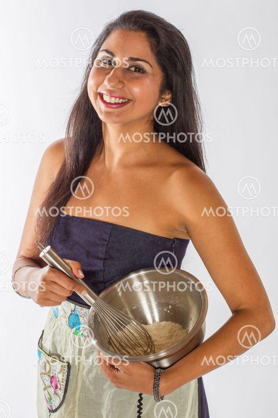 Smiling Indian Woman Mixing Cake