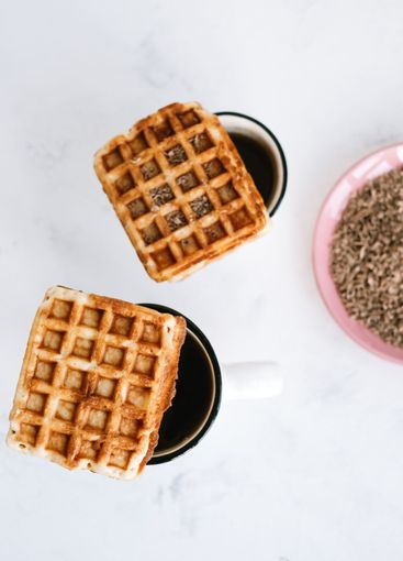 Sweet Belgian waffles on a cup of tea.