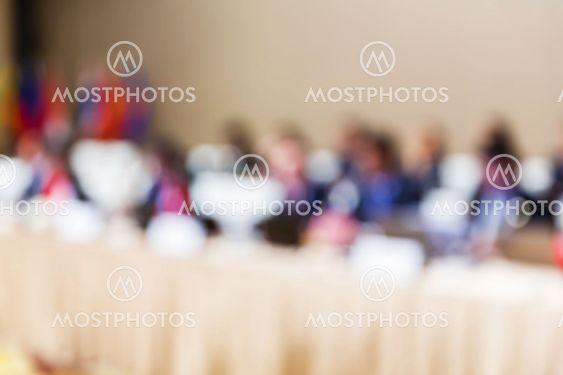 Blurred people in meeting room