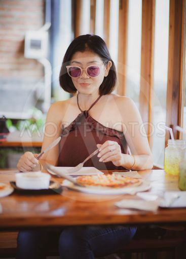 beautiful asian woman ready to eating  western food meal