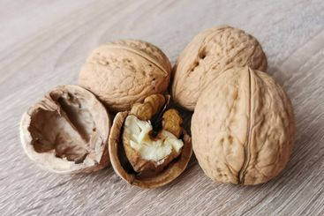 Three whole walnuts and one cracked walnut