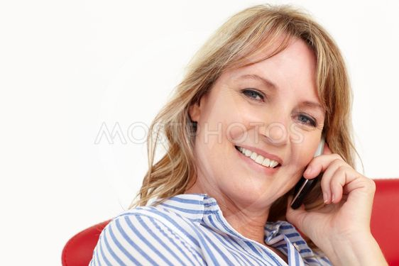 Mid age businesswoman using cellphone