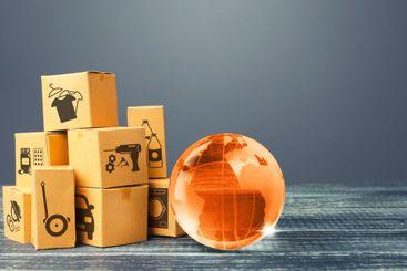 Orange glass earth globe and boxes. International world...