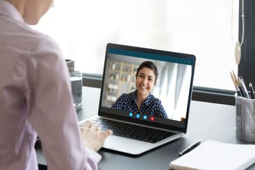 Indian girl communicates with friend on-line by video call