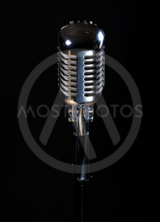 Professional vintage microphone isolated on black...