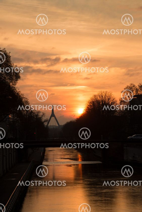 panorama on cityscape on the channel in mulhouse on sunset