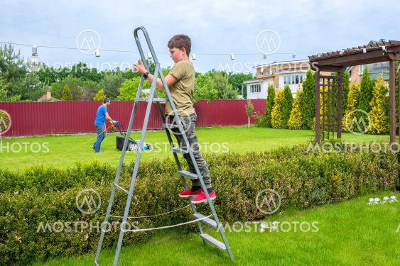 Garden work. A boy with his father are working in the...