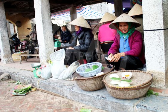 farmer woman selling rice cakes