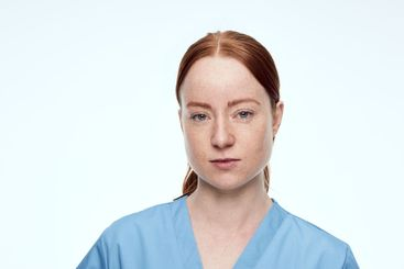 portrait of female nurse looking at camera serious