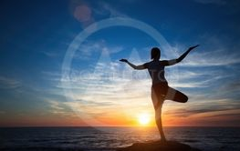 Silhouette young meditation woman practicing yoga on the...